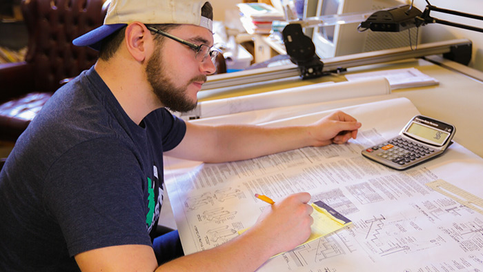 Cody Stone at the drawing table