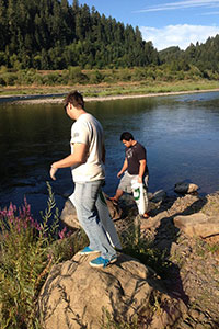 Michael and Kevin walking along the shore at the Tyee cleanup.